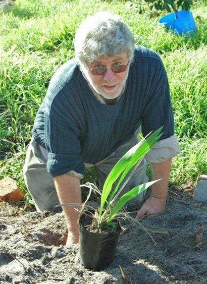 Patrick Dowling (pictured here doing some planting) believes that a Steady State Economy is now the way to go